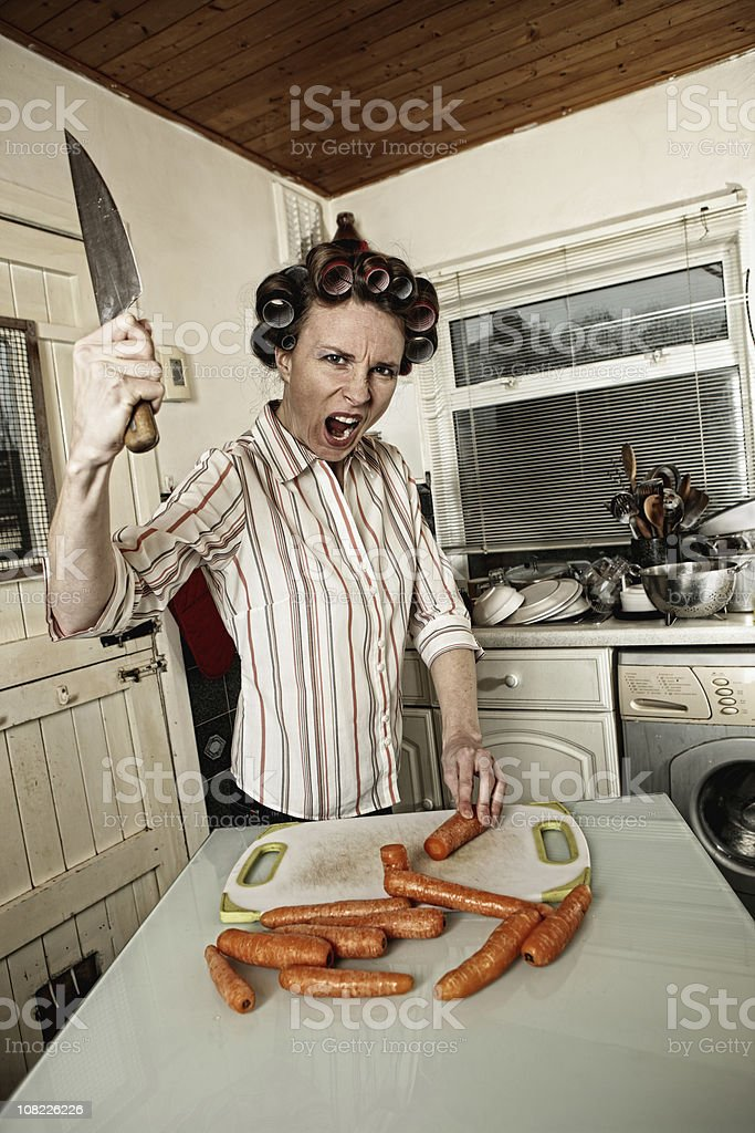 Mad woman in the kitchen royalty-free stock photo