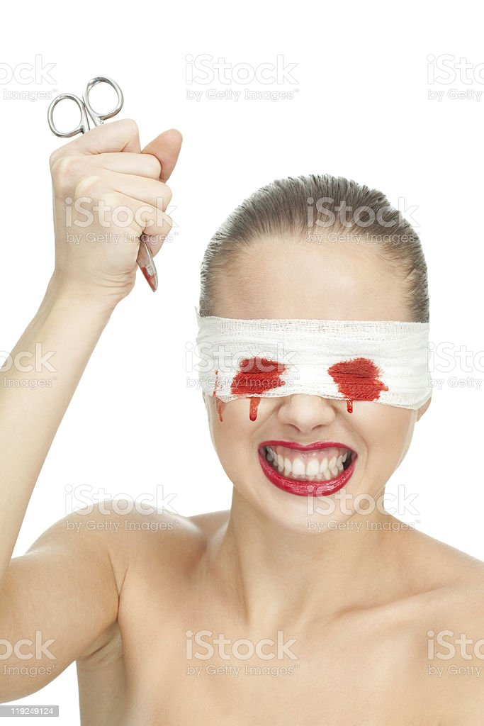 Mad woman with scissors stock photo