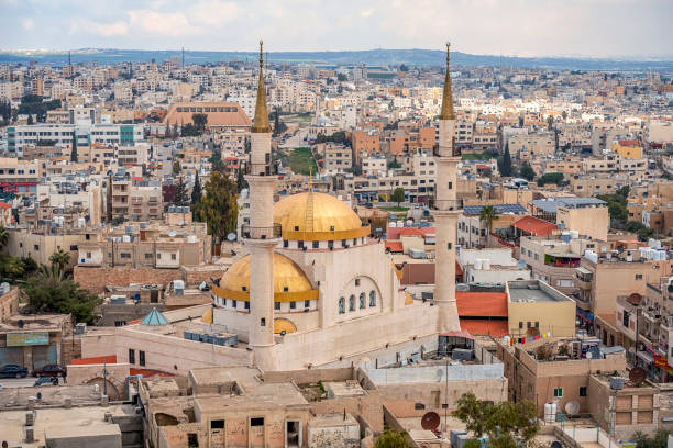 21/22/2019 Madaba, Jordan, view of the central and largest mosque with high minarets in the ancient city of the middle east. selective focus stock photo