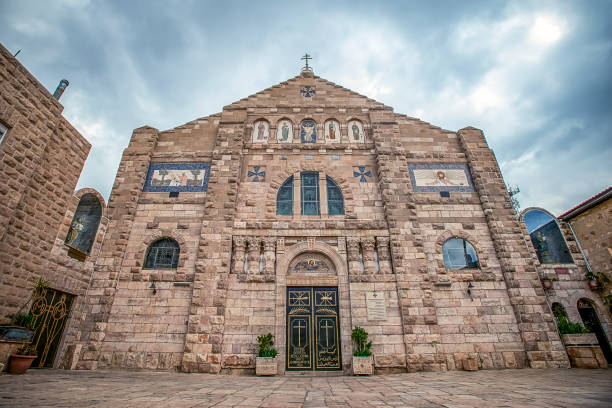 02/21/2019 Madaba, Jordan, view on the facade of St. John the Baptist Roman Catholic Church in the center of the ancient Middle Eastern city stock photo