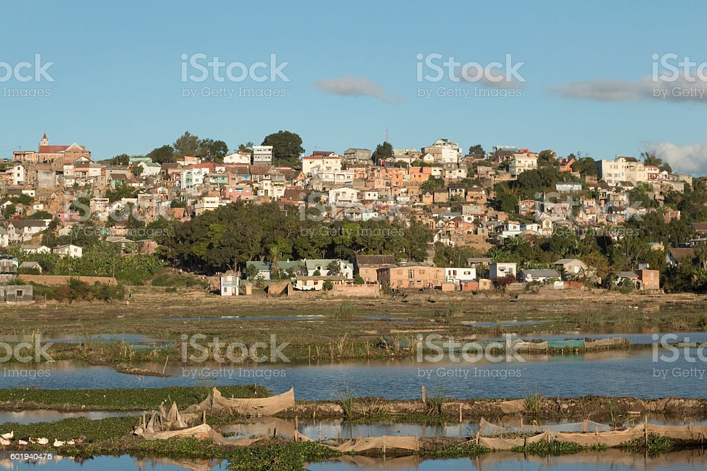 Madagascar Antananarivo wetlands rice paddy fields neighborhood homes stock photo