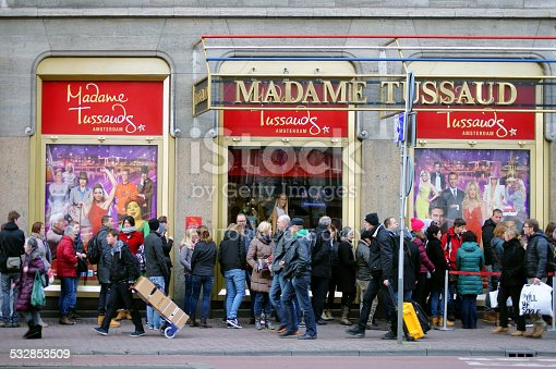 Amsterdam, The Netherlands - December 29, 2014: Tourists and visitors in front of the entrance of Madame Tussaud in a queue on December 29, 2014 in Amsterdam.