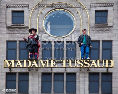 Amsterdam, Netherlands - December 16, 2012: House front of Madame Tussauds wax museum in Amsterdam. Madame Tussauds wax museums have branches in various major cities around the world and is a tourist attraction, displaying famous figures, film stars and others.
