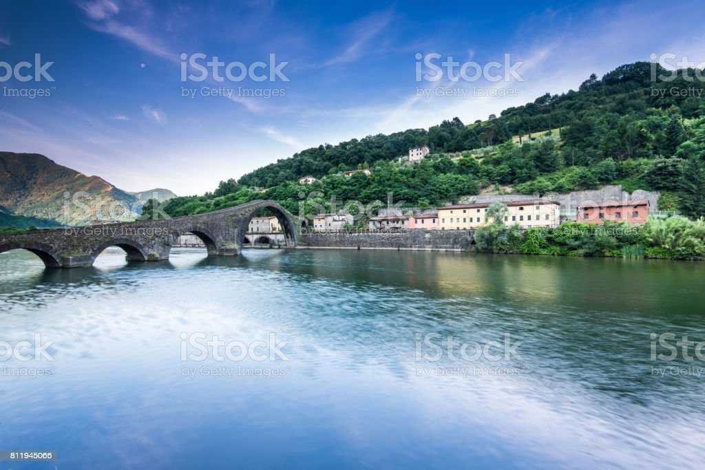 Maddalena Bridge over the Serchio river in Tuscany Italy stock photo