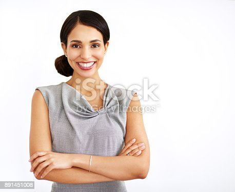 Studio portrait of an attractive young businesswoman posing against a white background