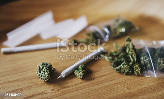 Shot of dried marijuana and a rolled joint