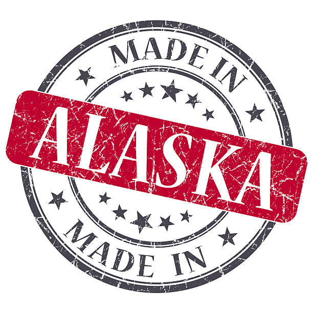 made in alaska red round grunge isolated stamp - alaska us state stock photos and pictures