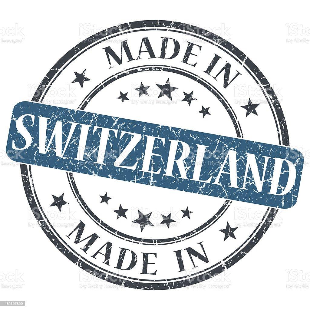made in Switzerland blue grunge round stamp stock photo