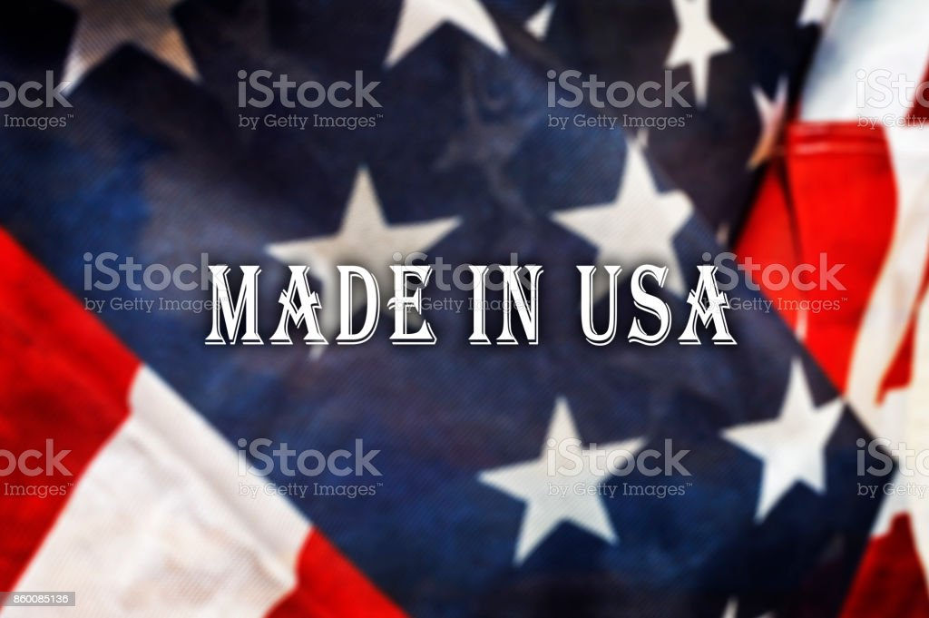 Made in the USA message on USA flag. stock photo