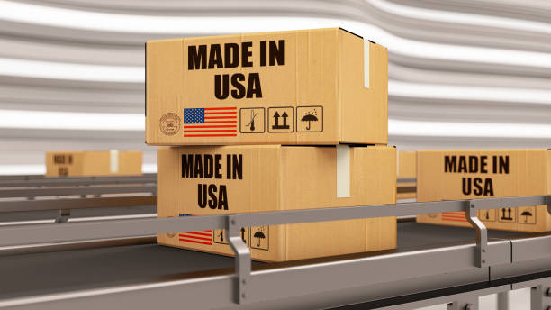 Made in USA United States. Cardboard Boxes on Conveyor Belt stock photo
