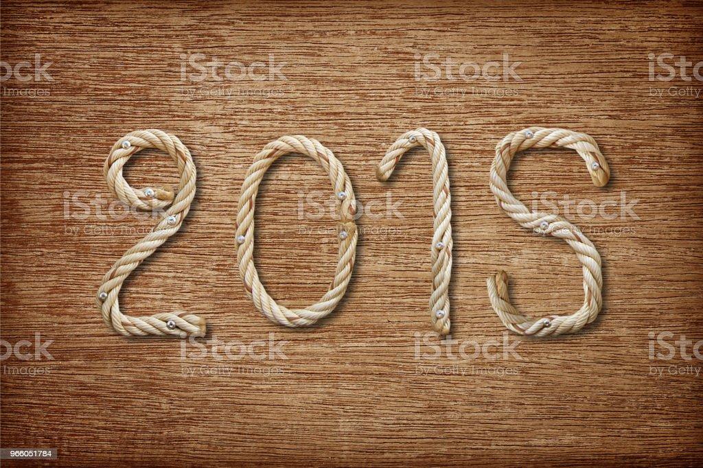 2015 gjorda av rep på trä bakgrund - Royaltyfri 2015 Bildbanksbilder