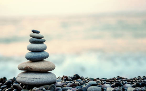 made of stone tower on the beach and blur background stock photo