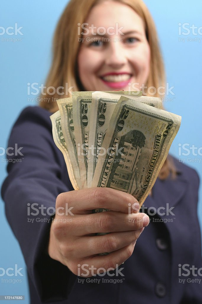 """Made Some Money! """"A happy business woman holding some 20's.  Shallow DOF, focus is on the money."""" Adult Stock Photo"""