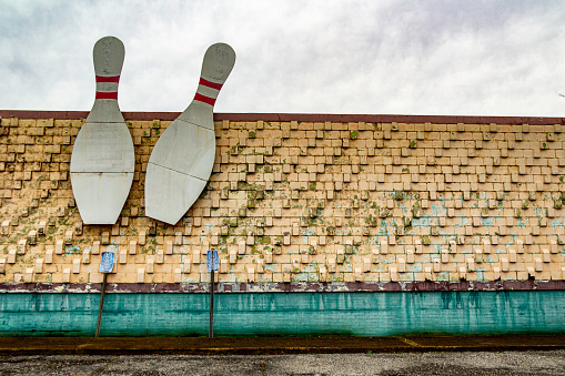 March 1, 2021 - Nashville, Tennessee, U.S.: Two giant bowling pins affixed to the outside of the dilapidated and boarded up Madison Bowling alley.