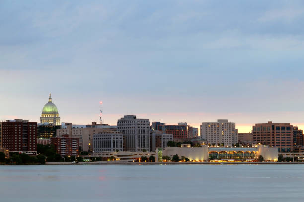 Madison cityscape with Capitol dome and Monona terrace. Madison downtown skyline. The capital city of Wisconsin skyline winter view across frozen lake Monona, from the Olin Park at dusk. madison wisconsin stock pictures, royalty-free photos & images