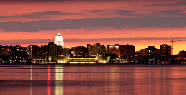 Madison downtown skyline. Downtown skyline of Madison, the capital city of Wisconsin, USA. After sunset view with State Capitol building dome and Monona Terrace against beautiful bright sky and reflection in lake water as seen across lake Monona. madison wisconsin stock pictures, royalty-free photos & images