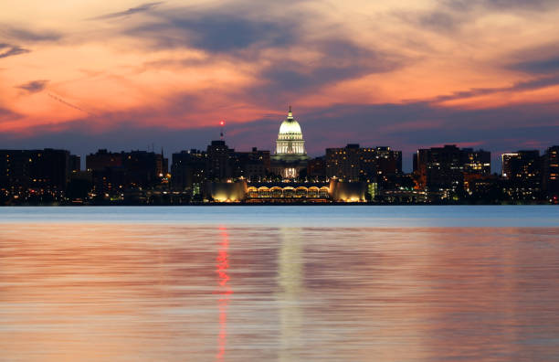 Madison downtown skyline Downtown skyline of Madison, the capital city of Wisconsin, USA.After sunset view  with State Capitol building dome against beautiful bright sky and reflection in lake water as seen across lake Monona. madison wisconsin stock pictures, royalty-free photos & images