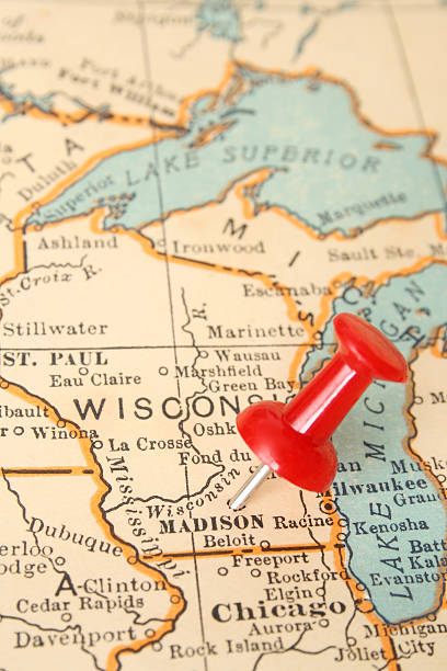 Madison Pushpin pointing Madison city, Wisconsin state capital, over more than fifty years old map dane county stock pictures, royalty-free photos & images
