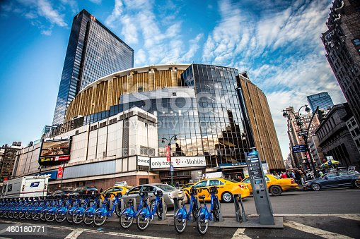 New York City, New York, USA  - December 21, 2013: Street view with pedestrians visible outside Madison Square Garden in New York City on December 21, 2013.  This landmark multi-purpose indoor arena, located above Penn Station opened in February 1968.