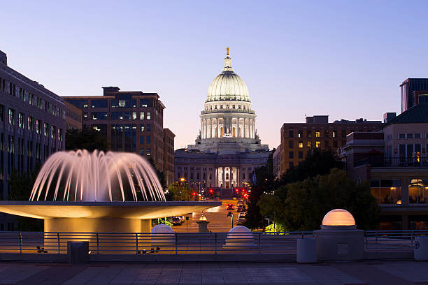 Madison, Wisconsin capitol building at night Madison, Wisconsin capitol building at night with fountain. Canon 6D on tripod. Adobe RGB color profile.   madison wisconsin stock pictures, royalty-free photos & images