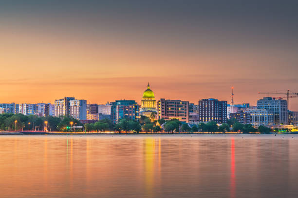 Madison, Wisconsin, USA downtown skyline at Lake Monona. Madison, Wisconsin, USA downtown skyline at dusk on Lake Monona. madison wisconsin stock pictures, royalty-free photos & images