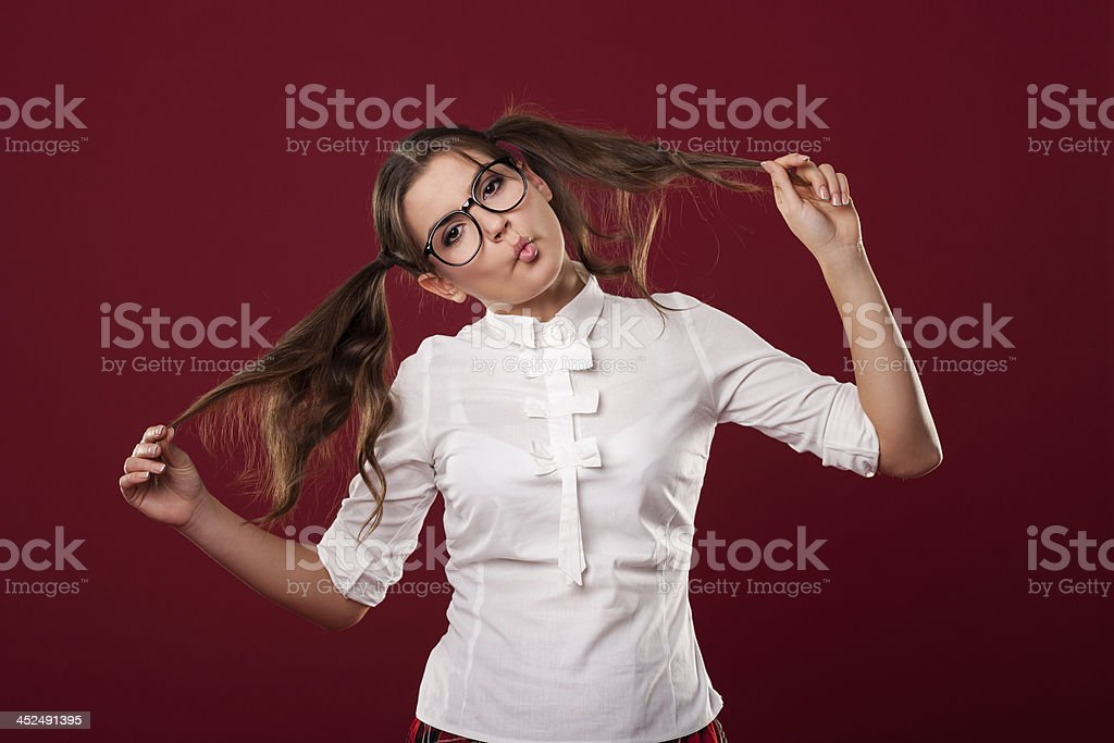 Madness woman with pigtails blowing kisses stock photo