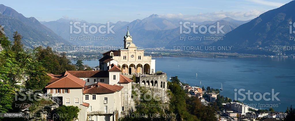 Madonna del Sasso, medieval monastery on the rock overlook lake stock photo