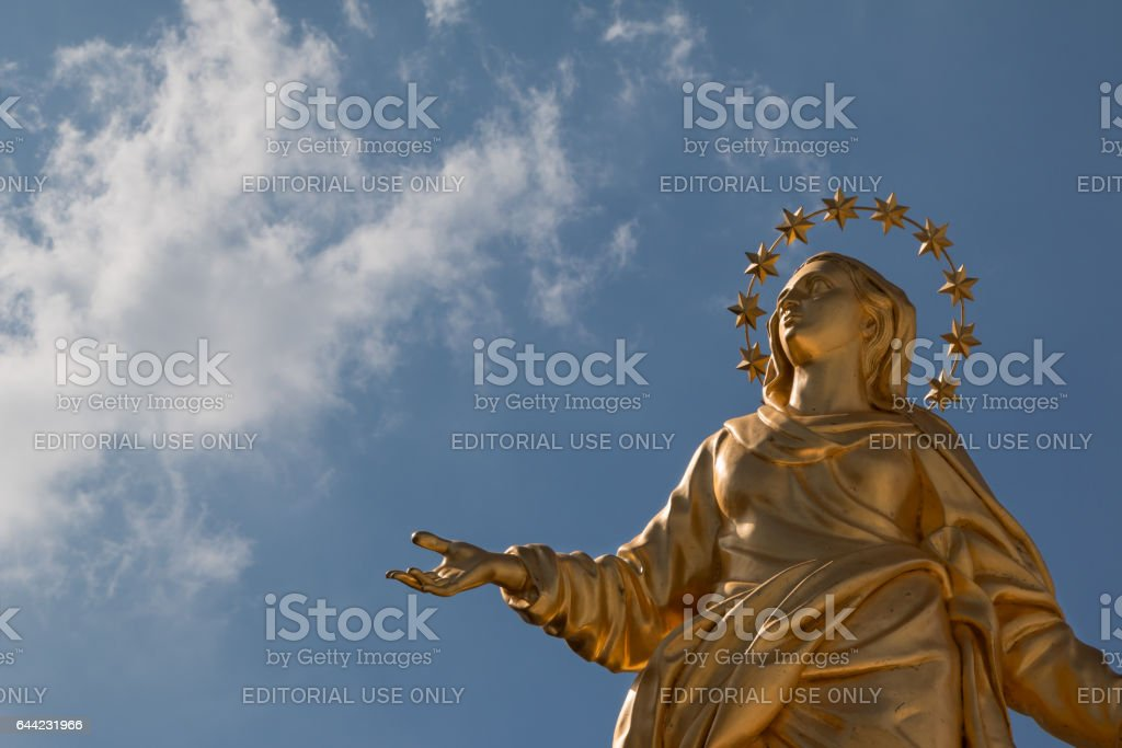 Milano, Italy - september 2015: Madonna Golden Statue Perfect Bronze Replica in Milan, Italy stock photo