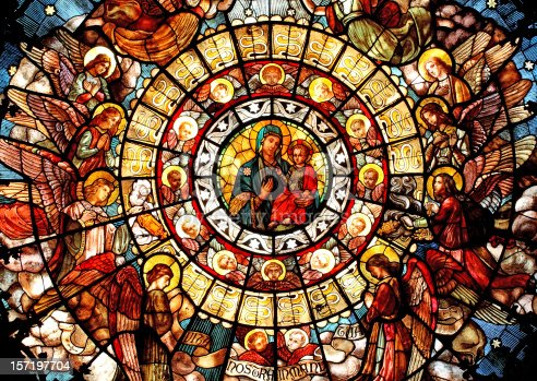 Rose window stained glass, dedicated to the Madonna of the Health, located in the San Camillo Church in Milano, Italy. This wonderful