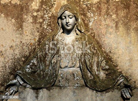 istock Madonna on a stone fresco. 831700430