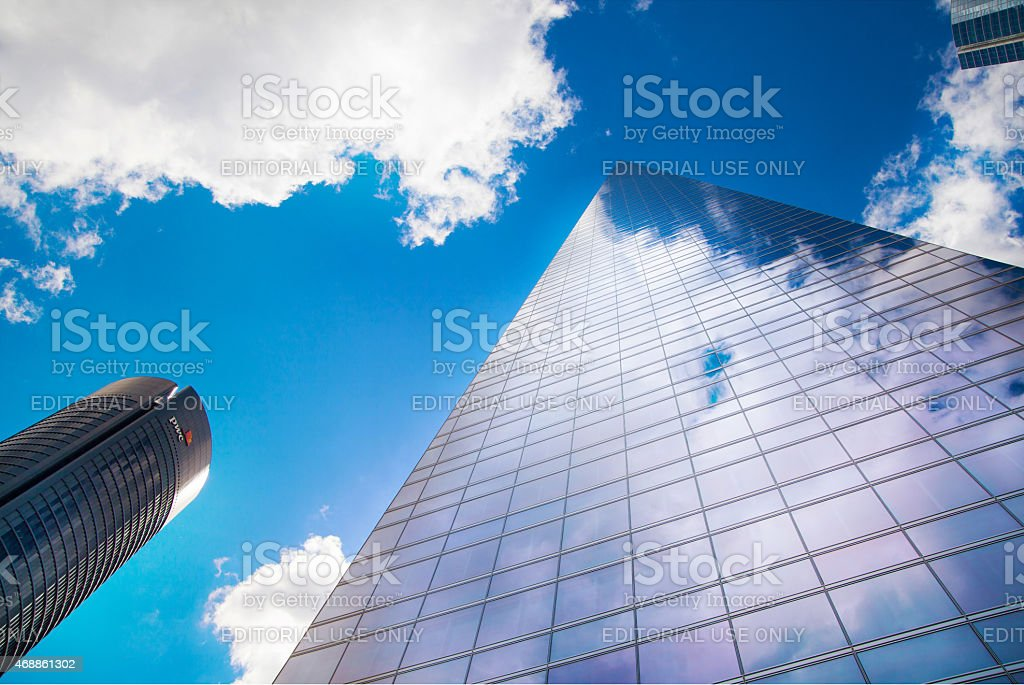 Madrid Cuatro Torres. Skyscraper against blue sky and clouds stock photo
