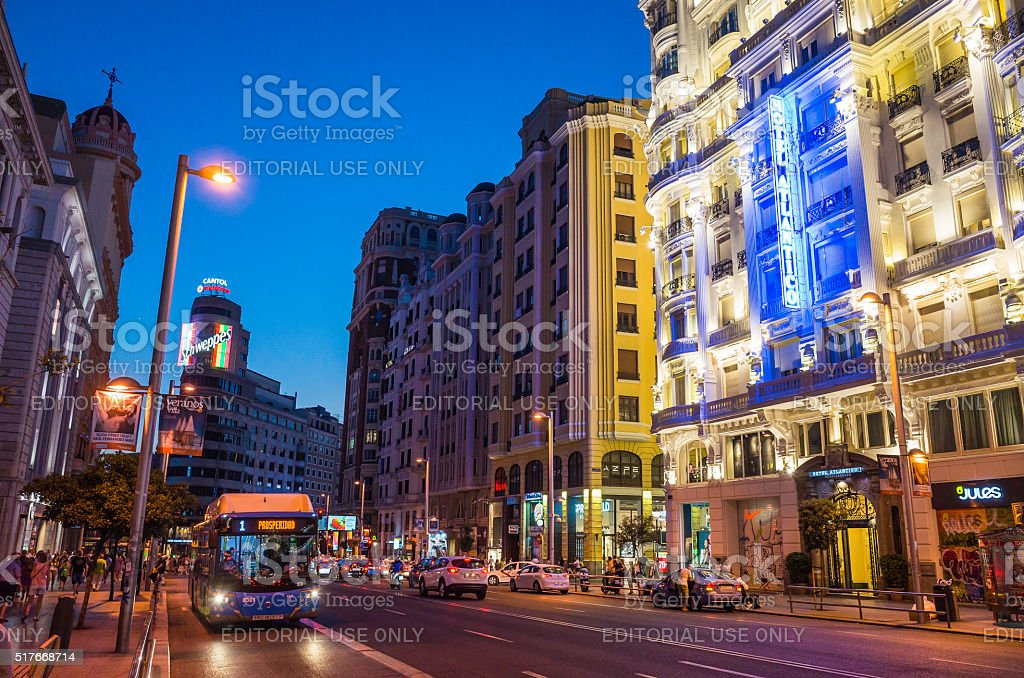 Madrid Gran Via busy shopping street illuminated at dusk Spain stock photo