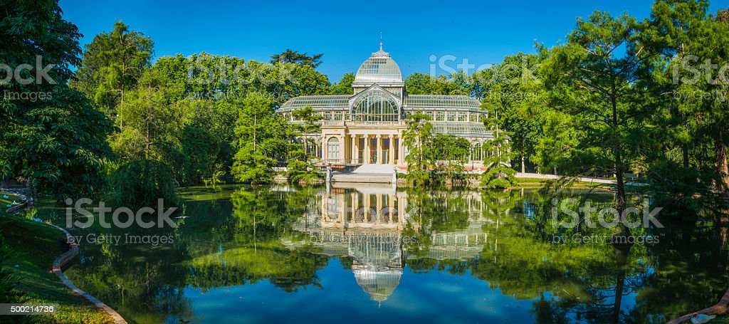 Madrid Palicio de Cristal Retiro Park tranquil lake panorama Spain stock photo