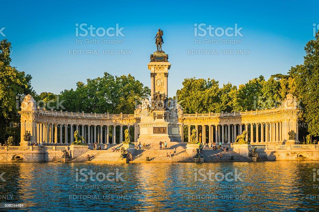 Madrid people relaxing beside boating lake in Retiro Park Spain stock photo