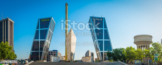 The iconic leaning skyscrapers of the Puerta de Europa reaching up into the blue dusk skies above the busy Plaza de Castilla in the downtown business district of Madrid, Spain's vibrant capital city.