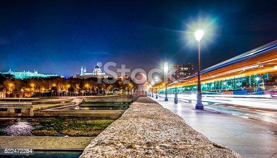 1154996700istockphoto madrid puente rio parque manzanares night light blur wide 522472284