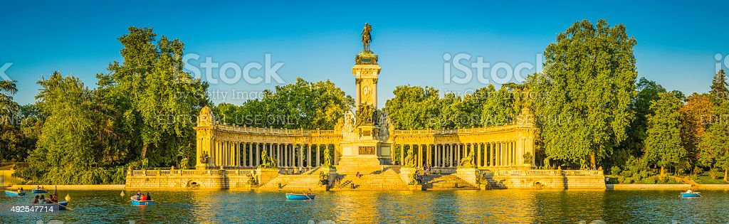 Madrid Retiro Park people enjoying sunset boating lake panorama Spain stock photo