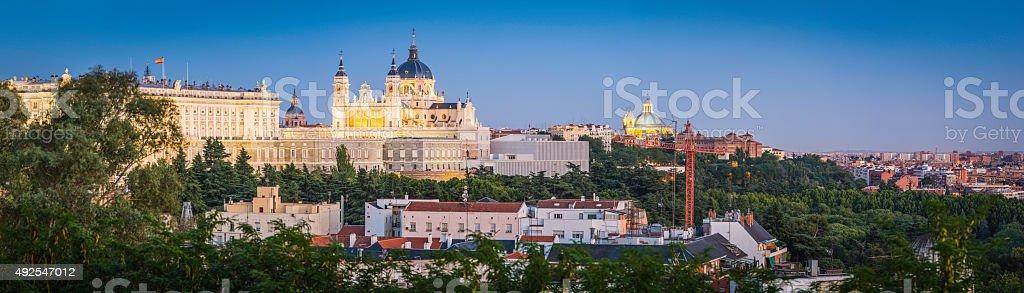 Madrid Royal Palace Cathedral iconic cityscape illuminated dusk panorama Spain stock photo