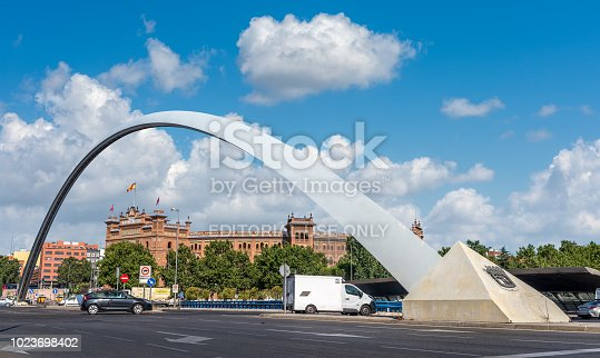 Madrid, Spain - July 31, 2018: Ventas Bridge that connects the districts of Salamanca and Ciudad Lineal crossing the M-30 of Madrid, at background the famous bullring Plaza de Toros de Las Ventas.