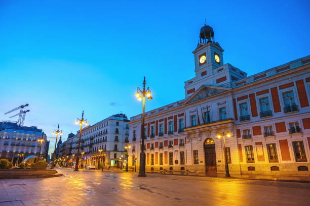 Madrid Spain, night city skyline at Puerta del Sol and Clock Tower of Sun Gate stock photo