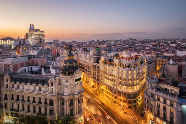 Madrid, Spain, Panoramic Aerial View of Historic Buildings on Gran Via at Sunset stock photo