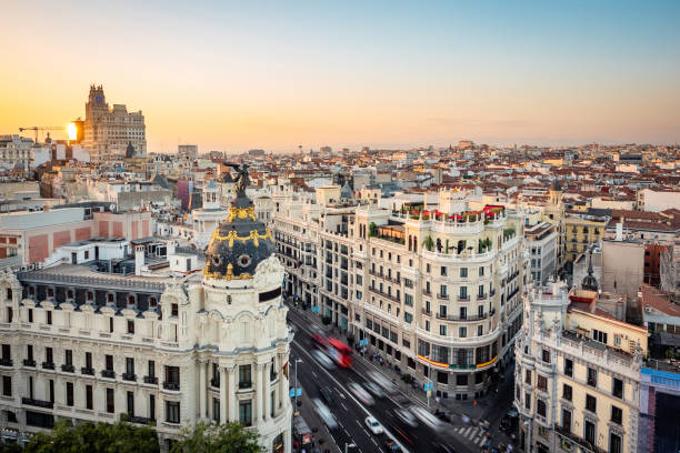 Madrid, Spain, Sunset Over Madrid Cityscape Showing Landmark Buildings on Gran Via Street Sunset over Madrid showing Gran Via street at landmark buildings in Central Madrid, the capital and largest city in Spain. romanesque stock pictures, royalty-free photos & images