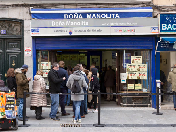 Madrid - Spanish Christmas Lottery tickets on sale at Dona Manolita lottery shop, people in line outside in Calle del Carmen. stock photo