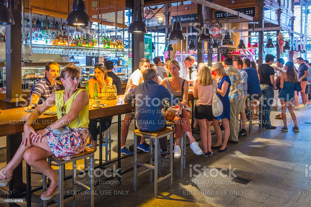 Madrid tourists and locals at bar restaurants San Miguel market stock photo