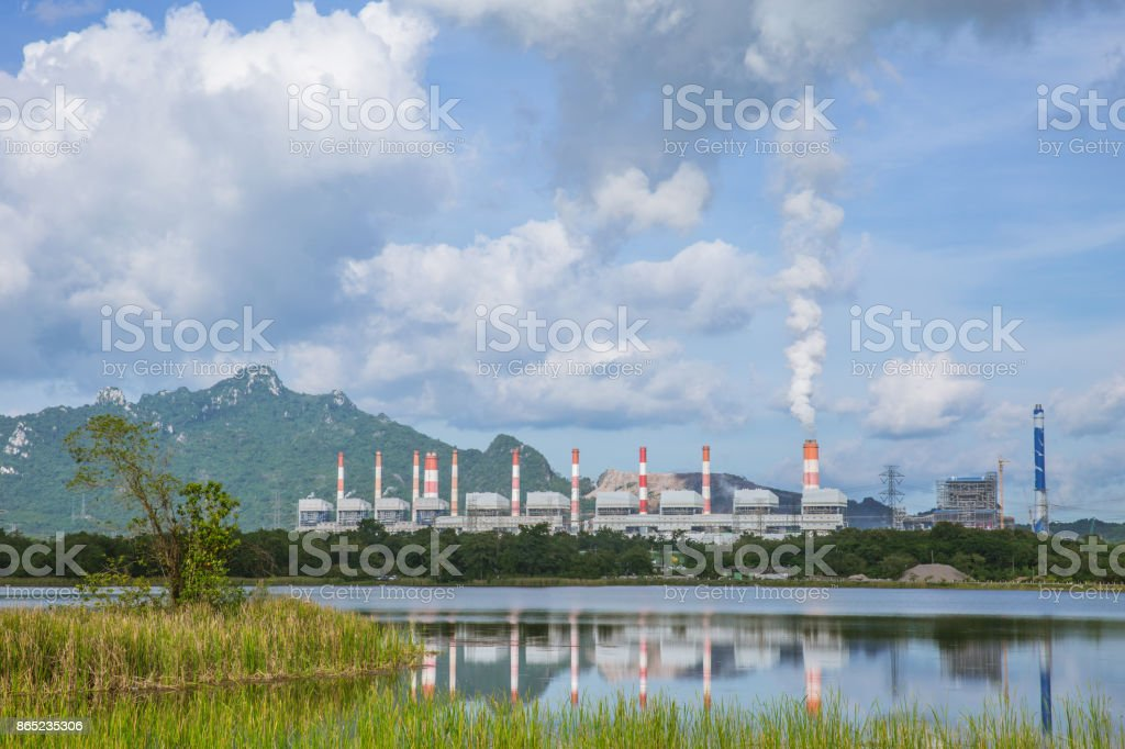 Maemoh coal power plant on working with sulfur smoke landscape day view from lake stock photo