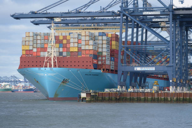 Maersk Line container ship Milan Maersk having containers loaded at Felixstowe port stock photo