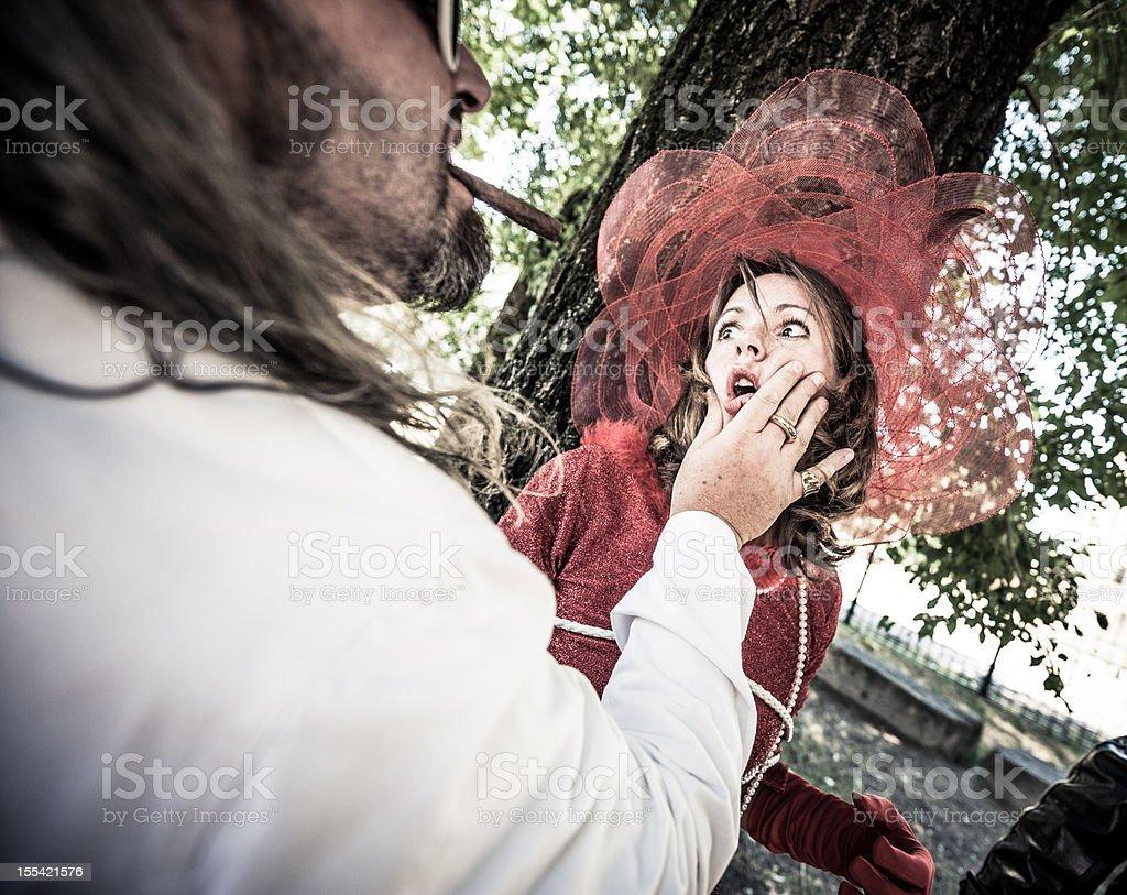 Mafia Boss threatening Woman in Fancy Dress stock photo