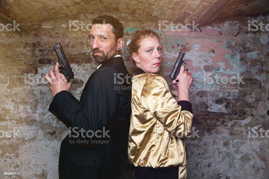 mafia couple with guns royalty-free stock photo