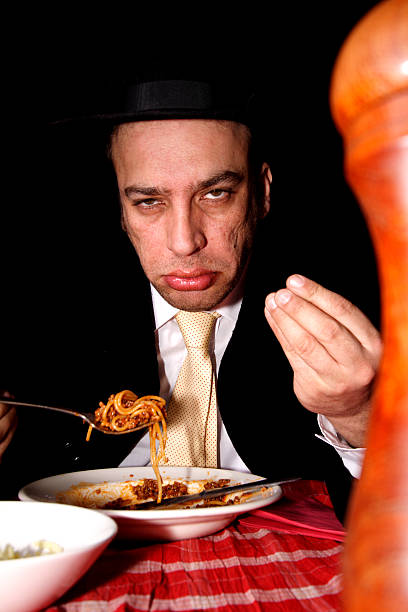mafia don eating spaghetti stock photo