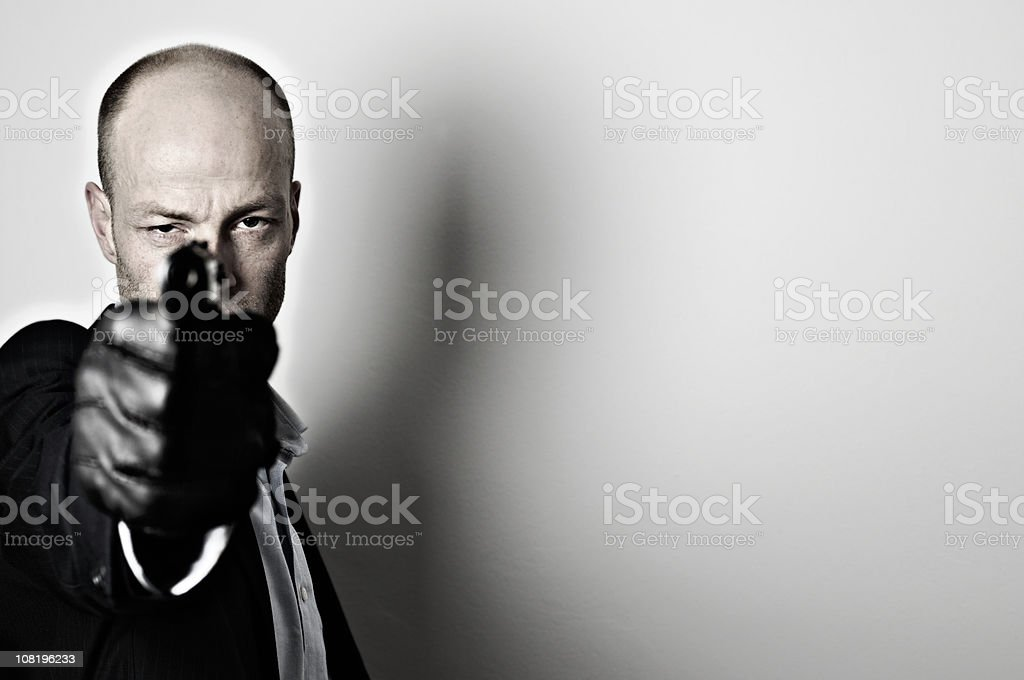 Mafia Man Holding Gun royalty-free stock photo
